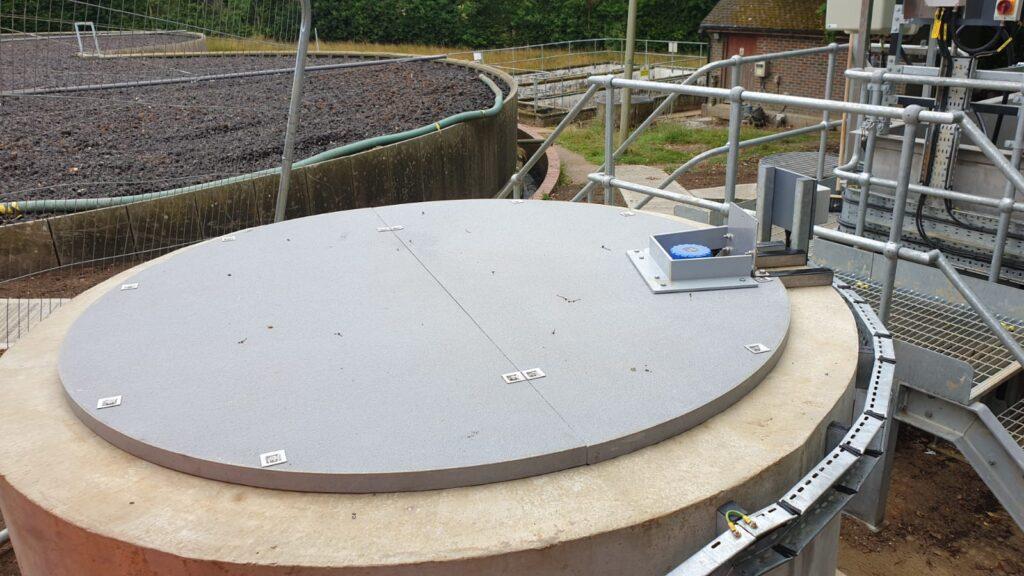 QuartzGrip Solid Top GRP panels cut to create a circuar sump tank cover